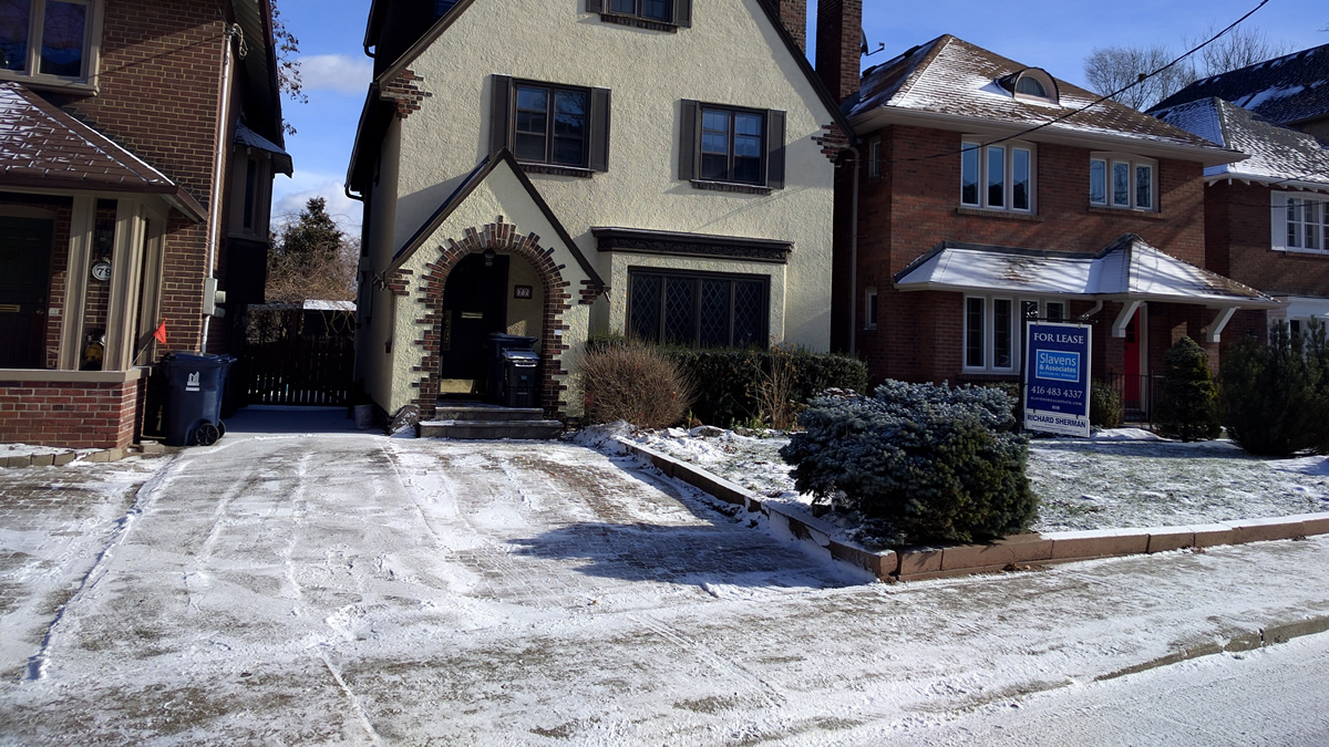 Snow removal services by Gardnezilla at a client house in Chaplin Estates in North Toronto