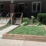 A new sod installation, garden planting, and retaining wall by Gardenzilla in East York off the Danforth