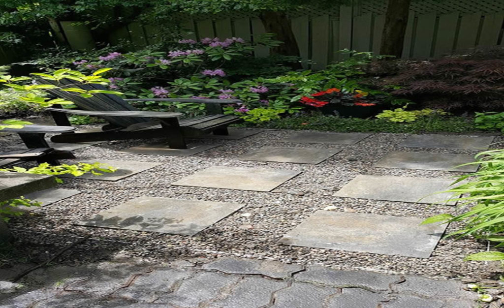 New patio and french drain by Gardenzilla