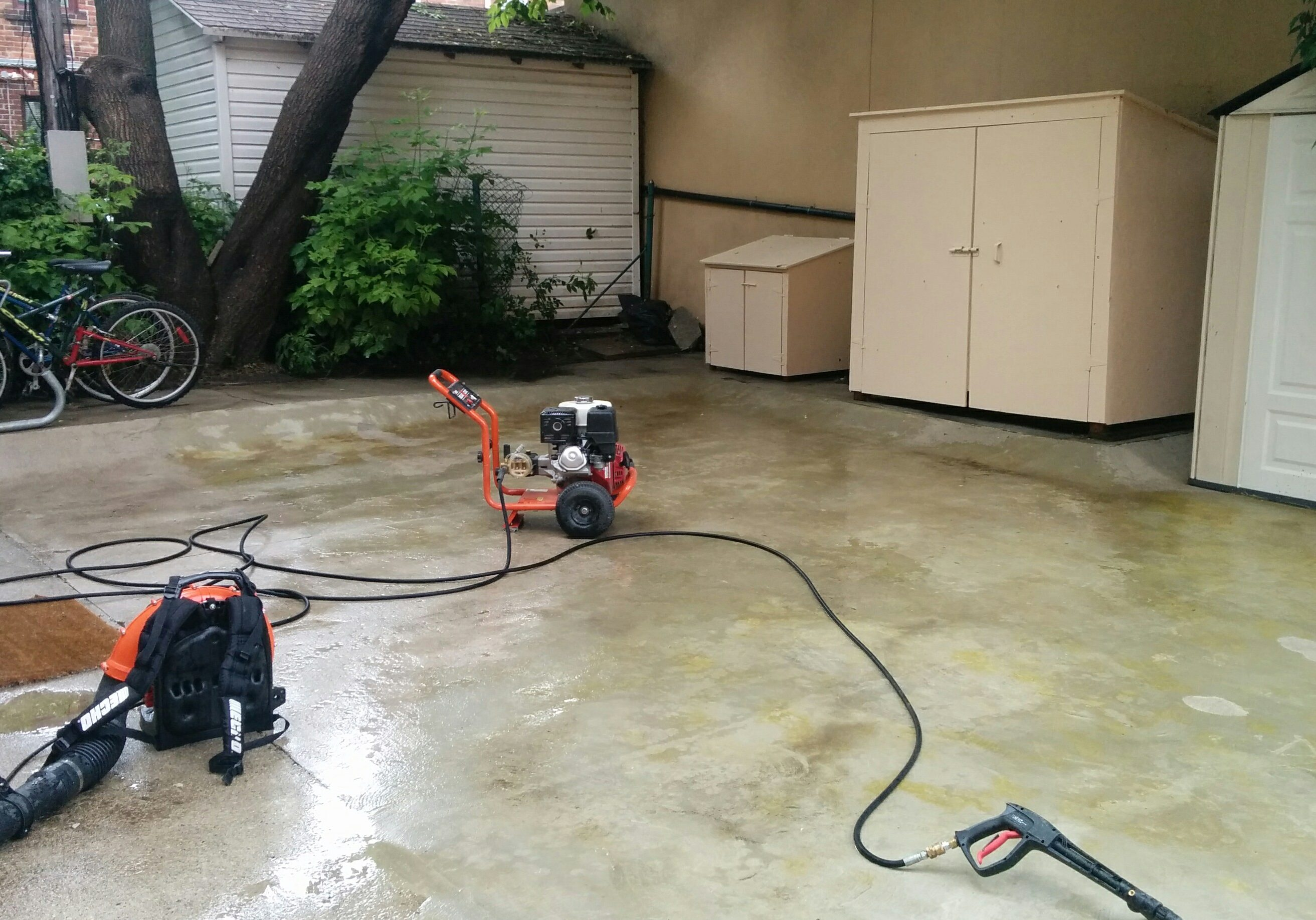 Photo of pressure washer being used for cleaning concrete by Gardenzilla in Midtown Toronto